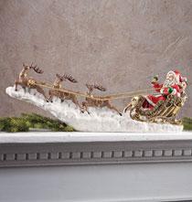 Santa in Sleigh Sculpture